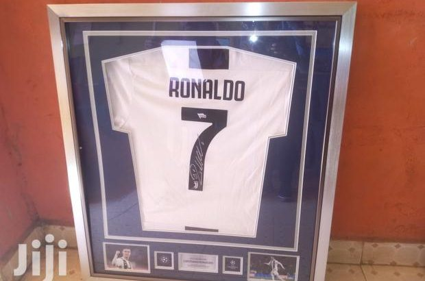 Signed and framed football jersey